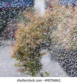 texture of broken glass on the background of autumn city