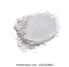 Texture of broken pearl white eye shadow isolated on white background. Macro texture of broken white powder