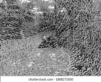 Texture of broken & shattered glass of a door window