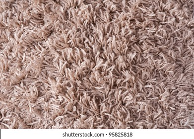 texture of a brown carpet with long pile