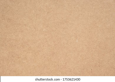 Texture of brown craft or kraft paper background, cardboard sheet, recycle paper, copy space for text.