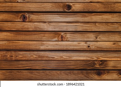 Texture of brown old wood with knots. Natural boards in wood stain.