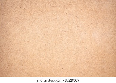 Texture of a brown panel with a soft vignetted