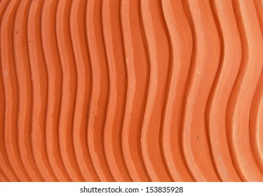 texture of brown terracotta clay surface with ripple