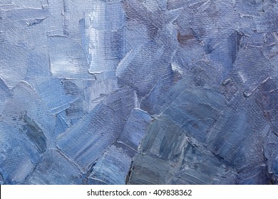 Texture of brushstrokes of blue paint on a canvas