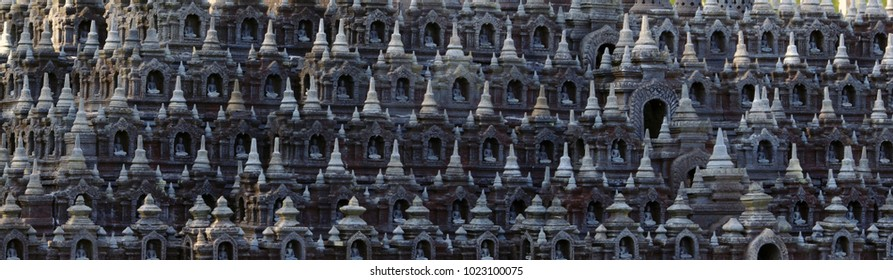 texture of Buddha sculptures on building. Asia