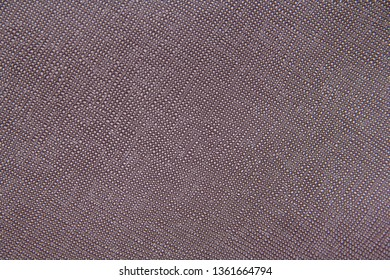 Texture of burgundy natural leather with lines and bumps. Backdrop or background.