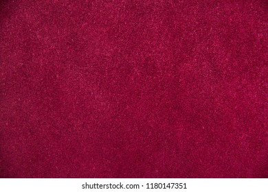 Texture of burgundy (red) suede