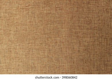 Texture of a burlap or gunny material, textile frame, buff canvas cloth background, fabric interior