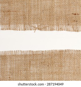 texture of Burlap hessian square with frayed edges on white background white space