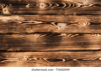 the texture of burnt boards