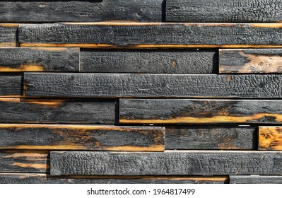 texture of burnt boards. Blackened charred wood planks with light veins. Burnt scratched hardwood surface. Background for Halloween.