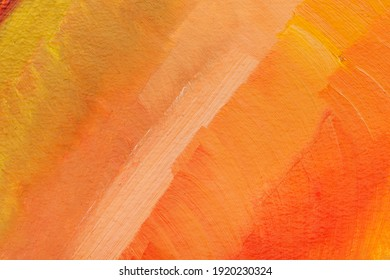 The texture of the canvas, coated with oil paints. Gradient in orange colors, copy space. The concept of a creative atmosphere, artistic events, education, etc.