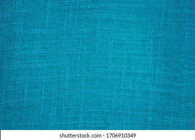 Texture canvas fabric as background, blue color