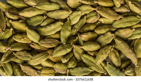 texture of cardamom seeds closeup, spice or seasoning as background. Organic food, healthy lifestyle, space for text. Top view,  Flat lay