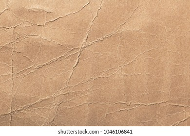 texture of cardboard with bends, background of crumpled paper