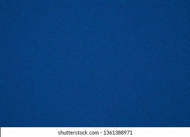 the texture of the cardboard in dark blue
