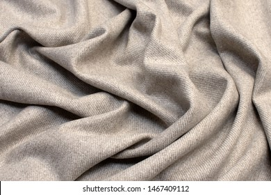 The texture of cashmere fabric beige. Background, pattern.