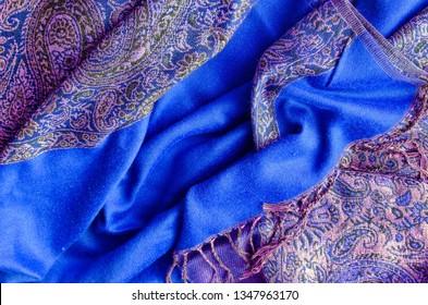 Texture of cashmere pashmina textile blue and golden colors