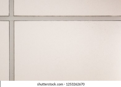 the texture of the ceiling in the office, part of the suspended white ceiling