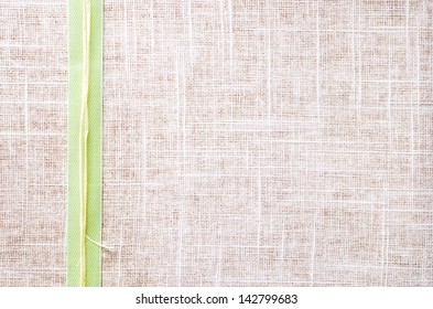 a texture of cloth with ribbon