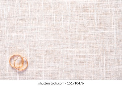 a texture of cloth with two golden rings