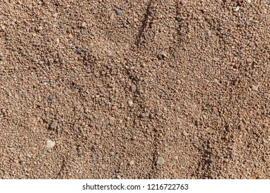The texture of coarse sand on the beach