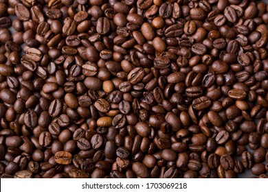 Texture of coffee beans on a gray background