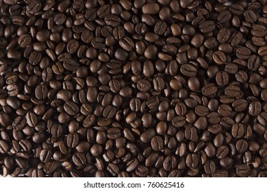 texture of coffee, with beautiful patches of light on the surface of grains