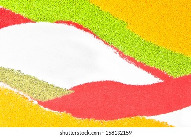 texture of colored sand, green, yellow, red, white and brown