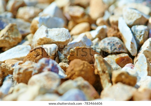 The texture of colorful gravel or macadam, background, close-up