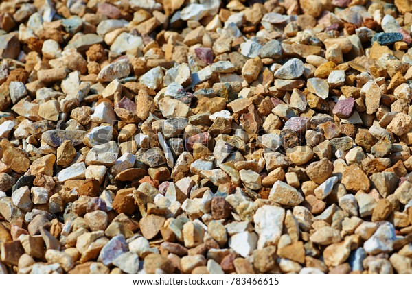 The texture of colorful gravel or macadam, background