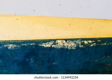 Texture of colorful metal background with a peeling cracked layers of paint.