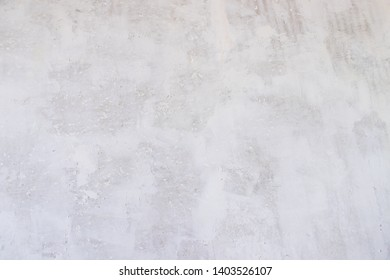 Texture concrete wall with putty. A thin layer of putty. White putty on a gray wall.