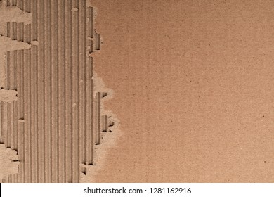 Texture of corrugated cardboard with torn edges. Texture cardboard packaging. Cardboard texture. Cardboard Mesh Background