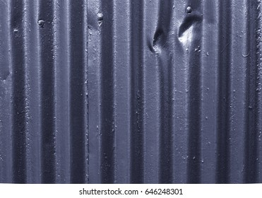 Texture of corrugated metal on the wall of traditional Iceland house for background. Toned.