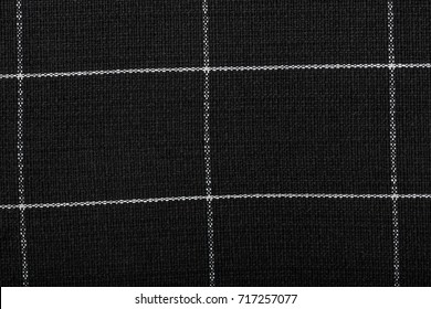 The texture of the cotton fabric. The fabric in black and white squares. The structure of the fabric. Fashion. Style. Square pattern. The pattern for textiles. Fashion Design and House Interior Design