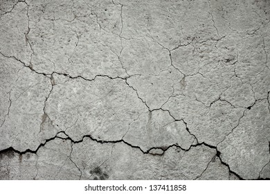 Texture of cracked grey stone wall