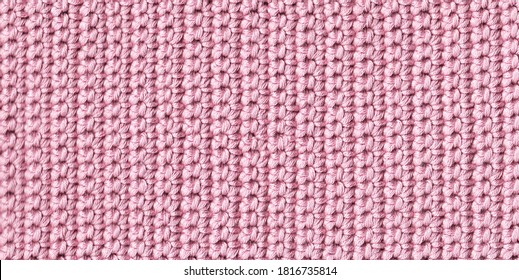 Texture of crocheted fabric of pink threads