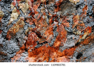 Texture of crude oil spill on the surface of the soil - environment pollution.