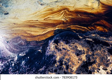 Texture of crude oil spill, pools of crude oil  floating on the surface of Saronic Gulf waters in Agios Kosmas bay, after the sinking of an oil tanker. Athens, Attica, Greece, September 14 2017.