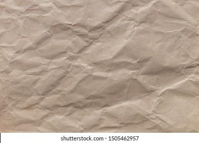 Texture of crumpled brown kraft paper