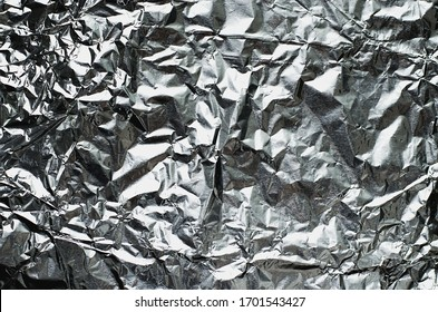 The texture of a crumpled metal foil spread out on a plane.