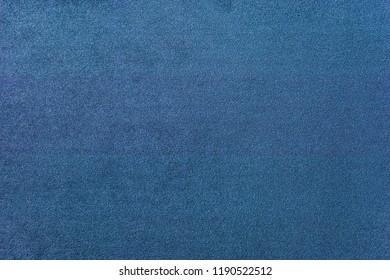 Texture of a dark blue carpet. Close-up of gradient light