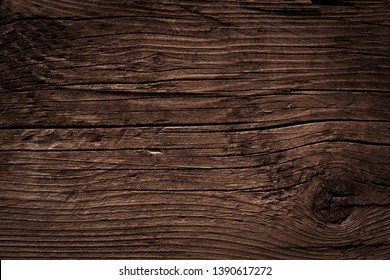 Texture of dark brown old rough wood. Abstract background for design. Vintage retro