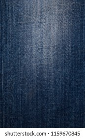 Texture of dark grated denim as background. Close-up