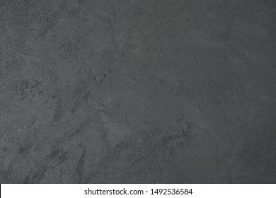 texture of dark gray wall with decorative plaster concrete effect