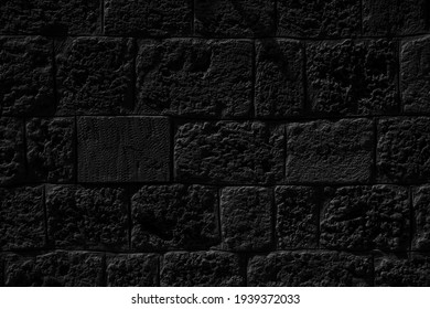 texture of a dark grey stone wall, space for text, space for copy