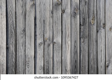 Texture of dark untreated wood, Old wooden laths background, Weathered larch background