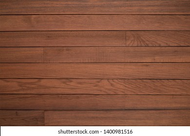 Texture of dark wood plank can be use for background. The dark wood background is on top view of natural wooden from the forest show texture of original wooden.